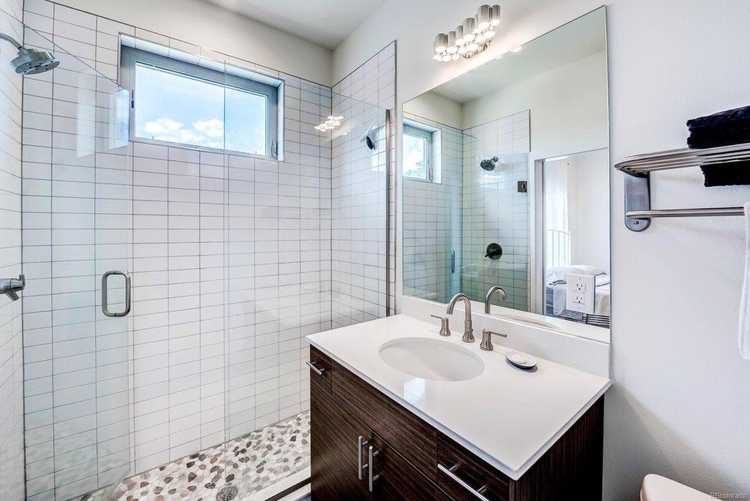 Bellaire st hale denver colorado bathroom remodel white black vanity circle mirror shower glass white subway tile