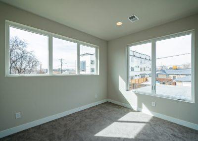 sustainable design build denver colorado west colfax 1365 zenobia master bedroom natural light mountain view