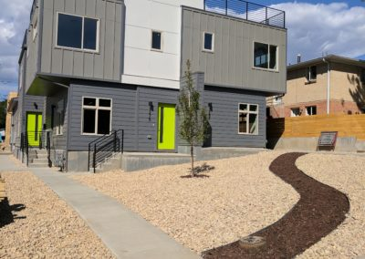 sustainable design build denver colorado west colfax 1275 Xavier front xeriscape rock mulch tree steel handrail