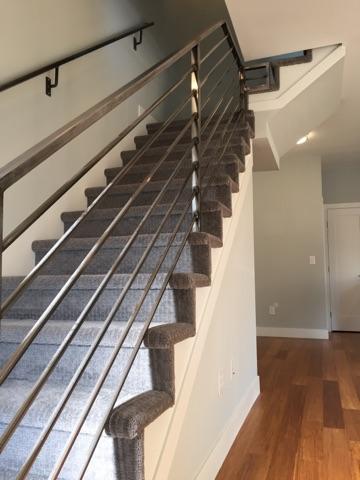 sustainable design build denver colorado west colfax 1275 xavier steel custom handrail