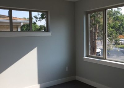 sustainable design build denver colorado west colfax 1275 xavier bedroom large windows natural light carpet
