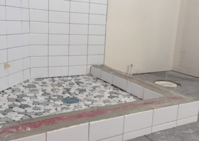 sustainable design build denver colorado west colfax 1220 perry during construction custom shower pan tile subway mosaic curb