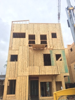 sustainable design build denver colorado west colfax 1254 perry during construction framing crane balcony parapet wall