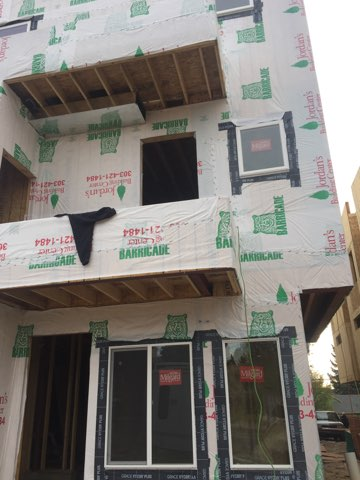 sustainable design build denver colorado west colfax 1254 perry during construction tyvek window siding install balcony