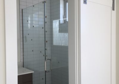 sustainable design build denver colorado west colfax 1220 perry during construction custom shower glass pan tile mosaic barn door cabinet vanity mirror
