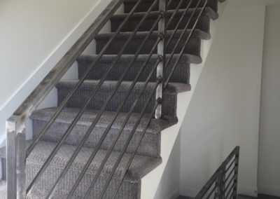 sustainable design build denver colorado west colfax 1220 perry during construction steel handrail stair stairway hallway