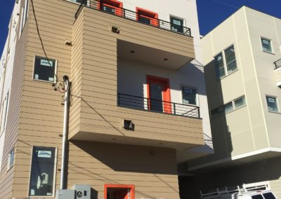 sustainable design build denver colorado west colfax 1220 perry during construction hardie siding paint exterior balcony electrical meter panel