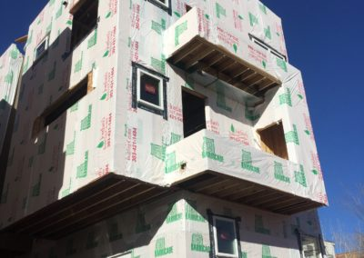 sustainable design build denver colorado west colfax 1254 perry during construction tyvek window install siding hardie