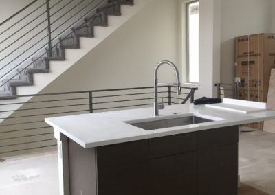 sustainable design build denver colorado west colfax 1220 perry during construction steel handrail kitchen bamboo hardwood floor quartz custom cabinets
