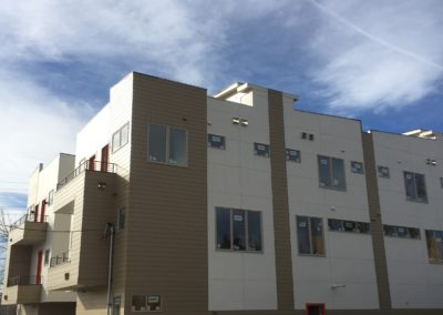 sustainable design build denver colorado west colfax 1220 perry during construction balcony hardie siding paint window install