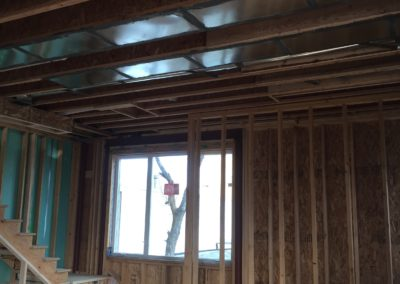 sustainable design build denver colorado west colfax 1254 perry during construction framing window install stair stairwell structural steel