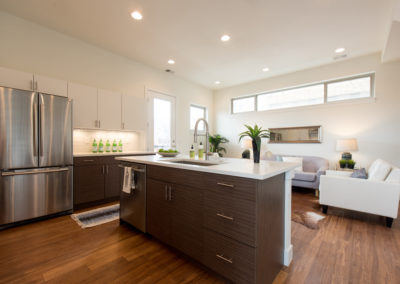 sustainable design build denver colorado west colfax 1220 perry kitchen custom island quartz coutertop open concept
