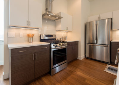 sustainable design build denver colorado west colfax 1220 perry kitchen custom cabinets quartz stainless appliances