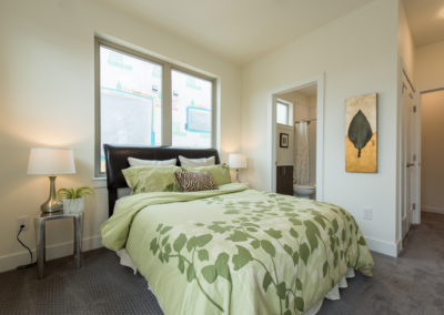 sustainable design build denver colorado west colfax 1220 perry bedroom large windows natural light en suite bathroom