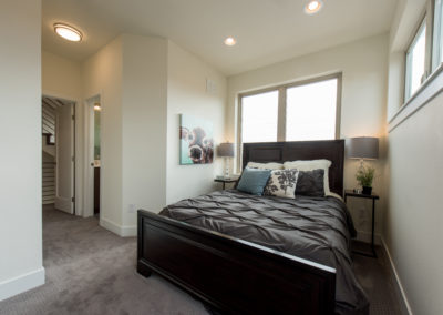 sustainable design build denver colorado west colfax 1220 perry master bedroom large windows natural light