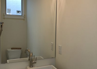 sustainable design build denver colorado west colfax 1220 perry during construction bathroom vanity custom mirror