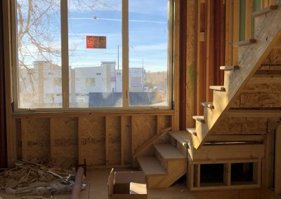 sustainable design build denver colorado west colfax 1254 perry during construction steel stairway framing window install