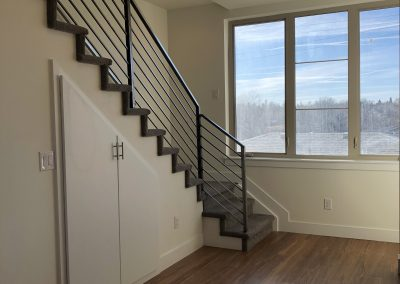 sustainable design build denver colorado west colfax 1220 perry during construction dining room stairway steel handrail bamboo hardwood
