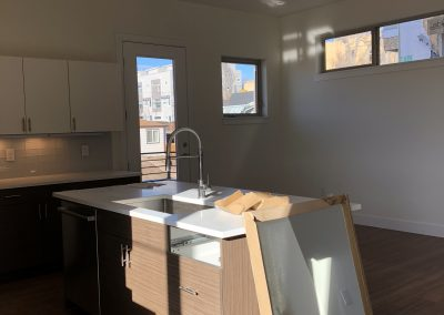 sustainable design build denver colorado west colfax 1220 perry during construction custom cabinet install quartz delta kitchen faucet