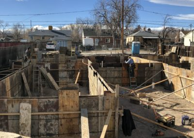 sustainable design build denver colorado west colfax during construction 1365 zenoibia foundation form pour