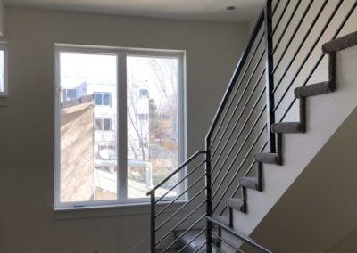 sustainable design build denver colorado west colfax 1254 perry hardwood staircase carpet steel handrail
