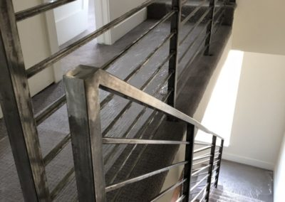 sustainable design build denver colorado west colfax 1254 perry staircase steel handrail
