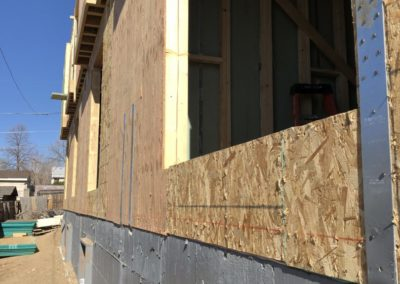 sustainable design build denver colorado west colfax 1265 xavier during construction foundation crawl space door structural strap