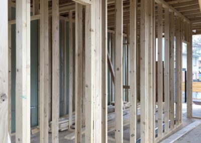 sustainable design build denver colorado west colfax 1265 xavier during construction framing bedroom wall