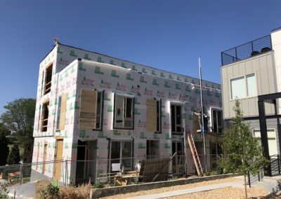 sustainable design build denver colorado west colfax 1265 xavier during construction tyvek window install siding