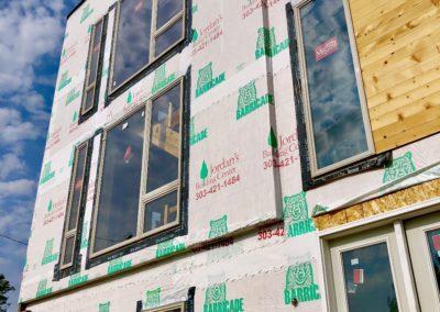 sustainable design build denver colorado west colfax 1265 xavier during construction cmu brick install blue stain pine tyvek sheathing