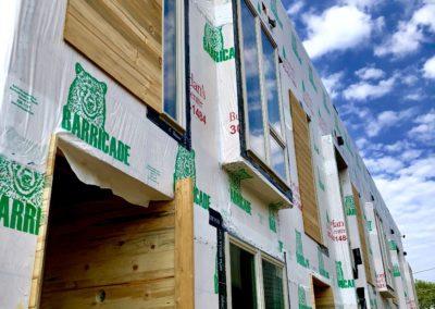 sustainable design build denver colorado west colfax 1265 xavier during construction cmu brick install blue stain pine
