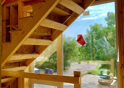 sustainable design build denver colorado west colfax 1265 xavier during construction staircase large windows natural light