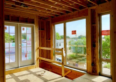 sustainable design build denver colorado west colfax 1265 xavier during construction framing window install roof deck natural light