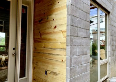 sustainable design build denver colorado west colfax 1265 xavier during construction cmu brick blue stain pine