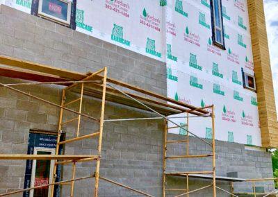sustainable design build denver colorado west colfax 1265 xavier during construction cmu brick install