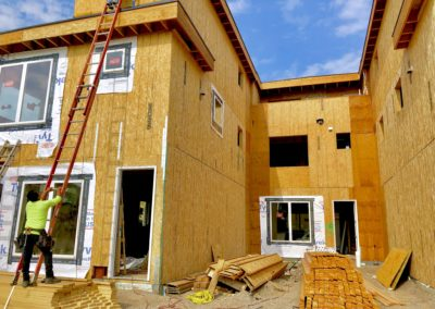 sustainable design build denver colorado west colfax 1365 zenobia during constructionframing sheathing window install structural straps