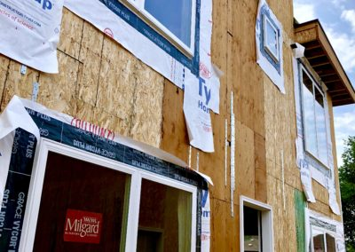 sustainable design build denver colorado west colfax 1365 zenobia during construction structural straps window install
