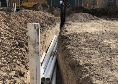 sustainable design build denver colorado west colfax 1374 yates during construction sewer install trench