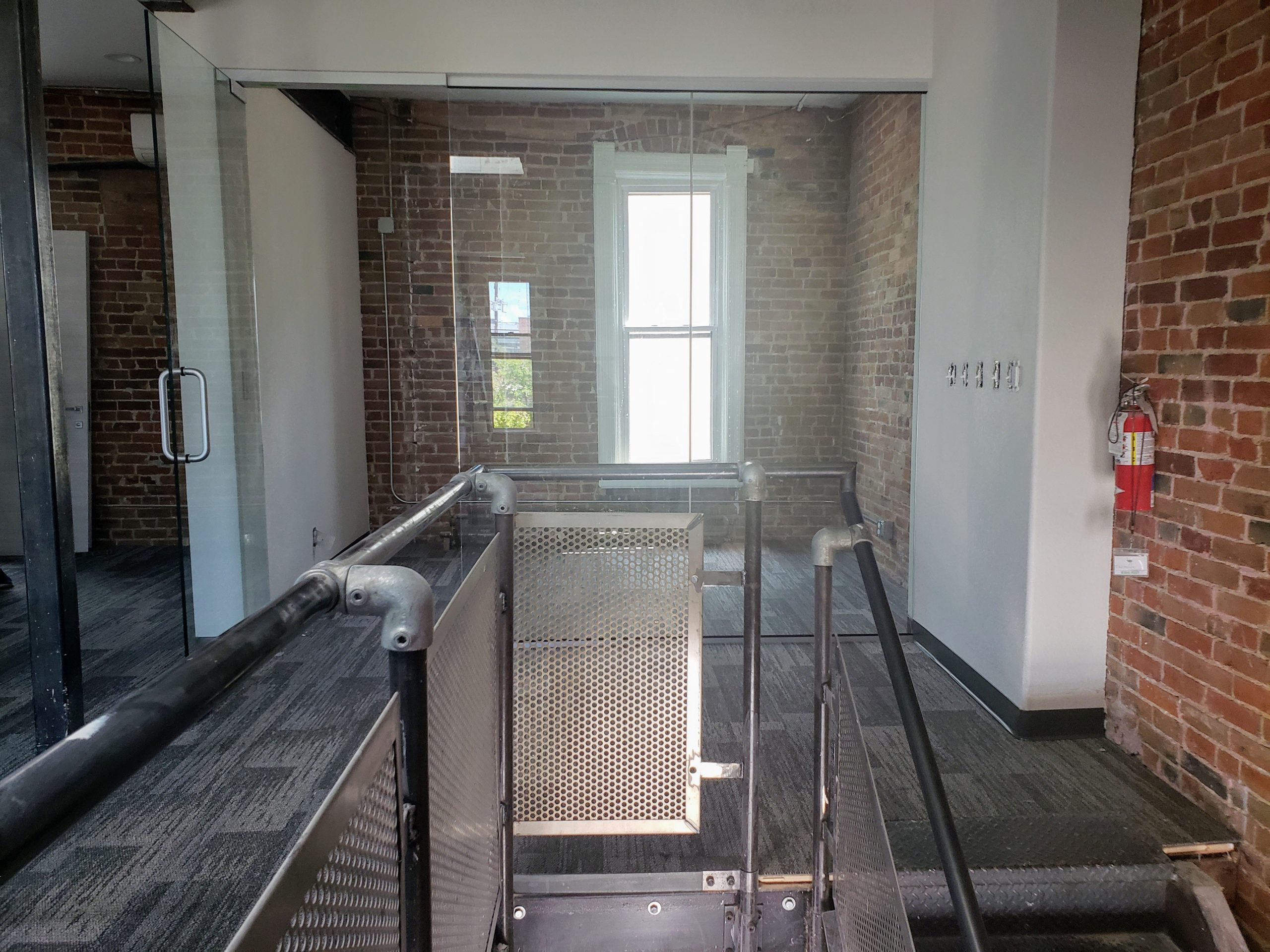 Summit Church Office stairs iron steel railing glass walls stairwell