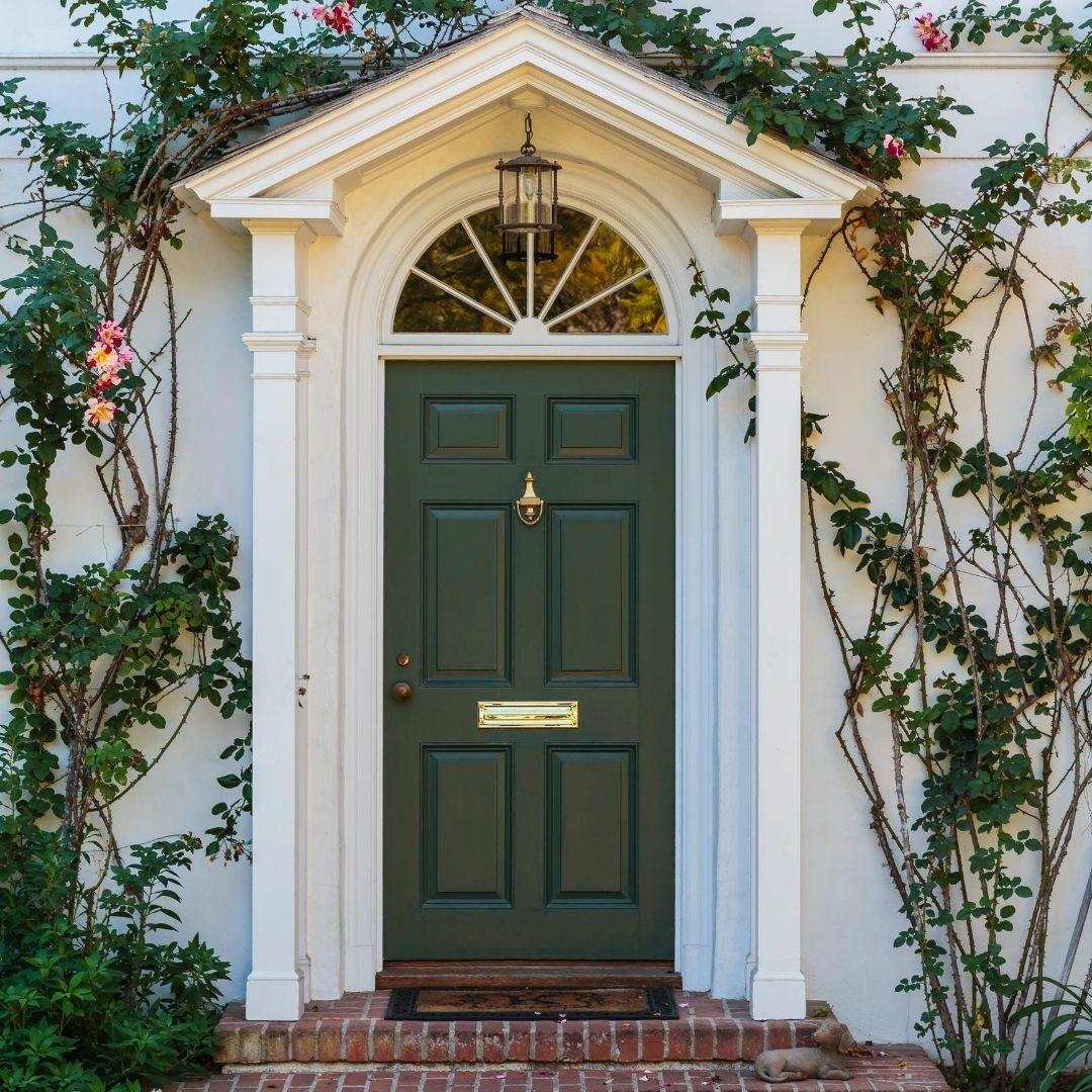 front door entryway green vines white old colonial gold plate window beautiful home goals
