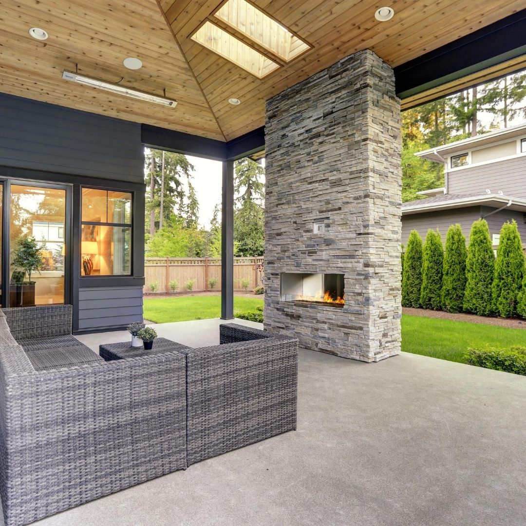 fireplace cement backyard patio furniture glass walls doors slider green grass how much money do i have to make to get something like this
