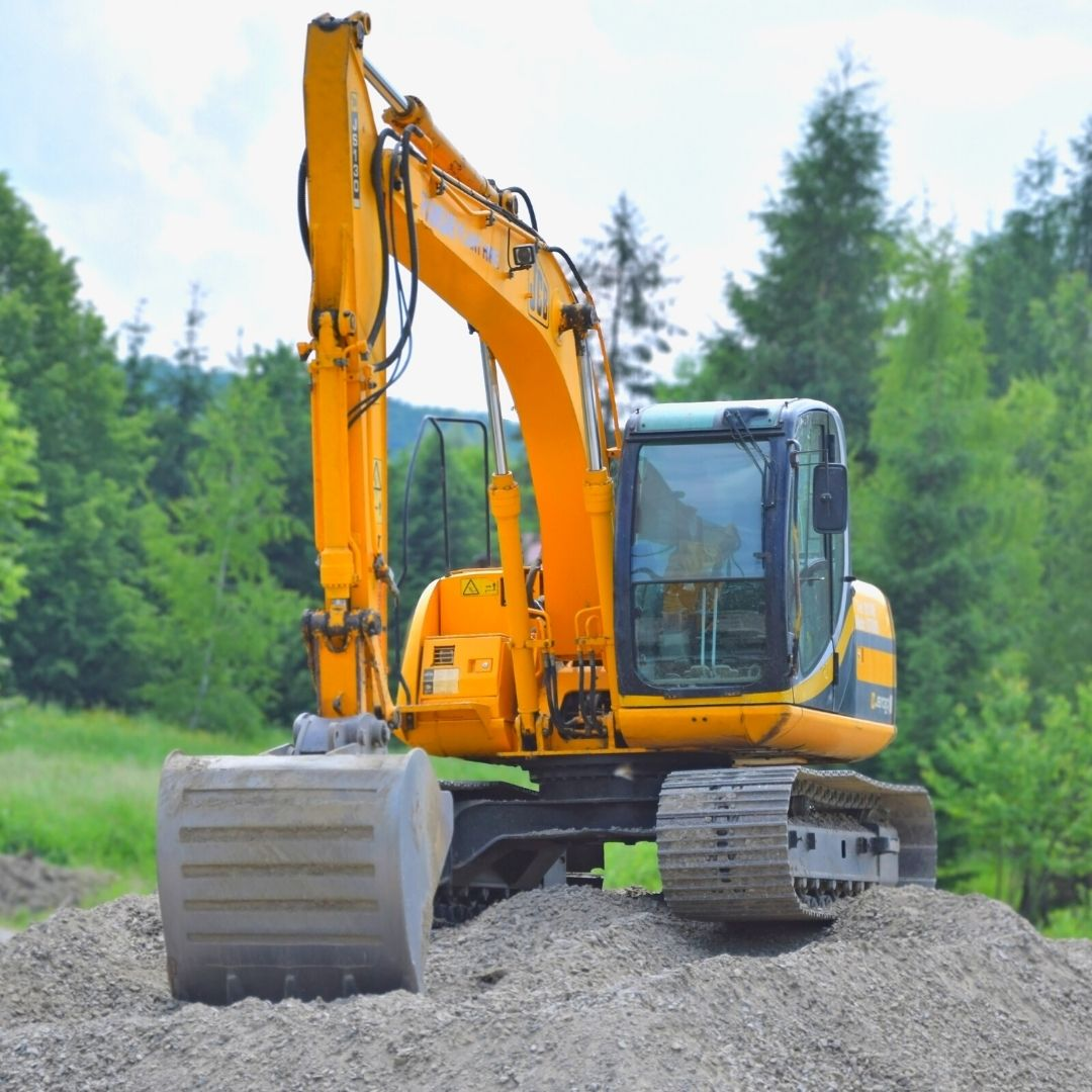 yellow dragon construction machine trees gravel dirt building adu
