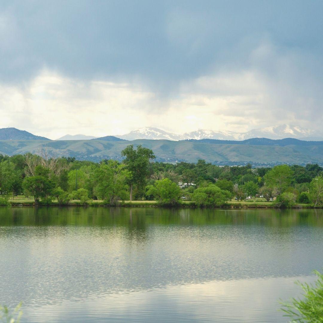 Sloans Lake denver mountain green trees clouds adu